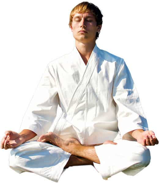 Martial Arts Lessons for Adults in Orlando FL - Young Man Thinking and Meditating in White