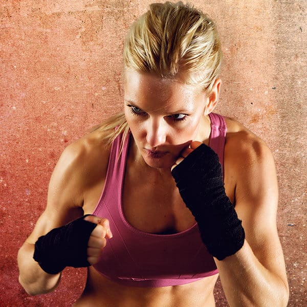 Mixed Martial Arts Lessons for Adults in Orlando FL - Lady Kickboxing Focused Background