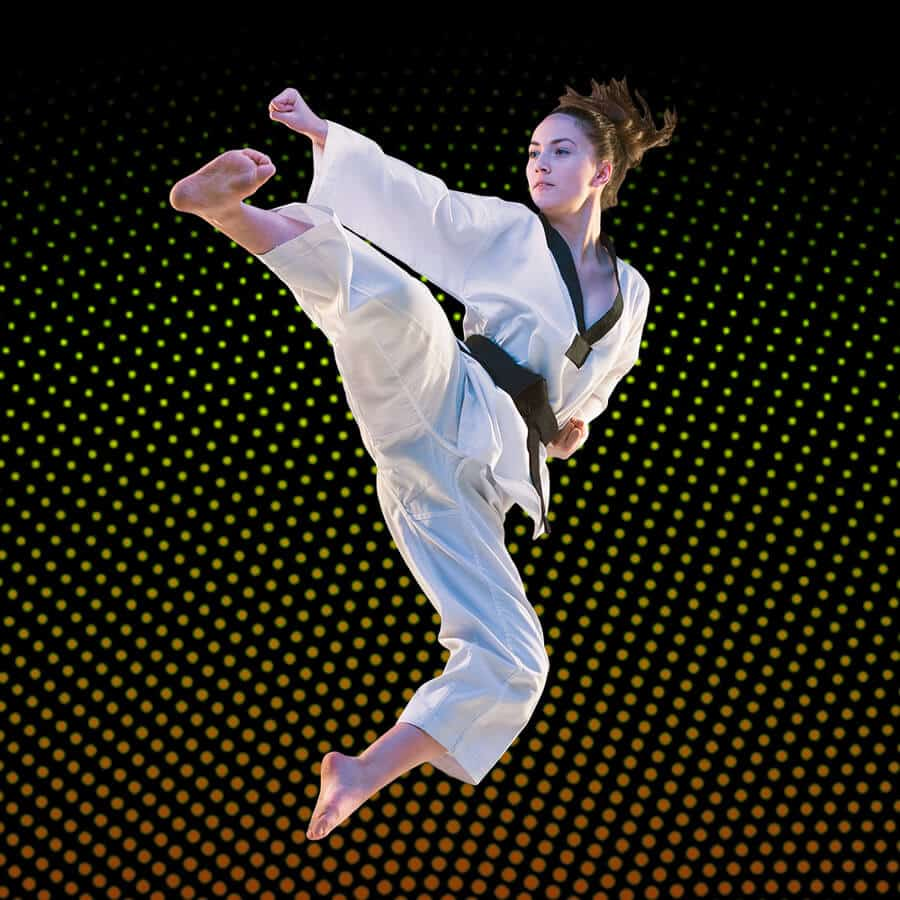 Martial Arts Lessons for Adults in Orlando FL - Girl Black Belt Jumping High Kick