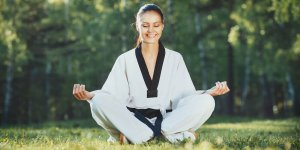 Martial Arts Lessons for Adults in Orlando FL - Happy Woman Meditated Sitting Background